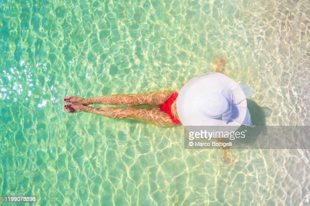 woman relaxing on the beach in playa del carmen, quintana roo, mexico - maillot de bain photos et images de collection