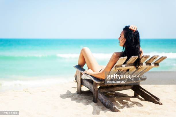 woman relaxing on the beach - chaise longue stock photos and pictures