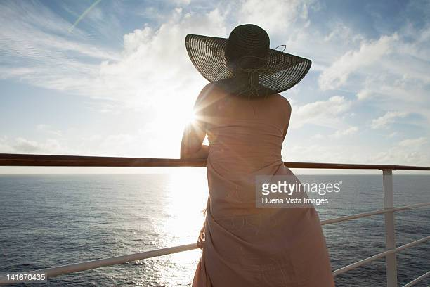 Woman relaxing on the deck of a cruise ship