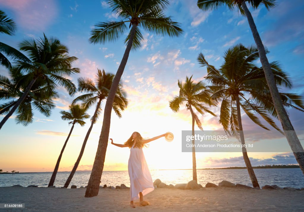 Woman relaxing on tropical beach : Stock Photo
