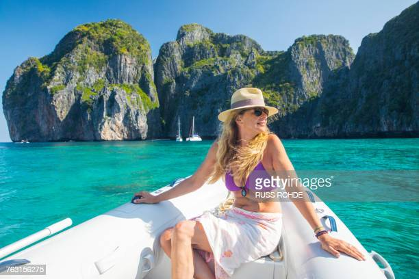 Woman relaxing on yacht, Koh Phi Phi Leh, Thailand, Asia
