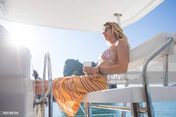 Woman relaxing on yacht, Koh Roi, Thailand, Asia