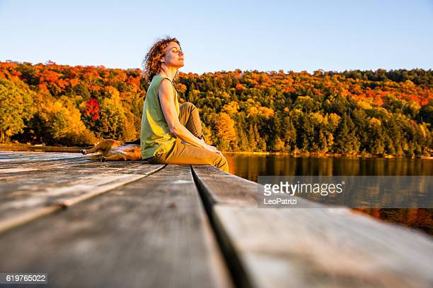 Woman relaxing outdoor by the lake in Canada