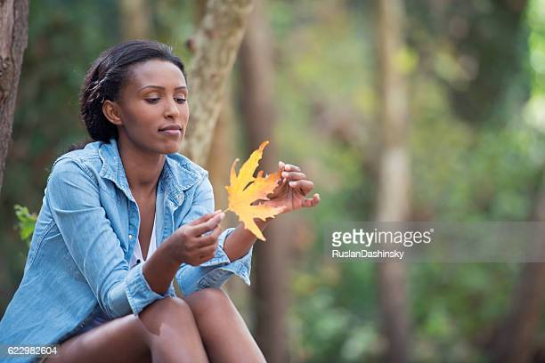Woman relaxing outdoors in fall.