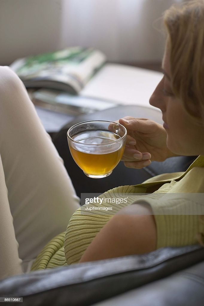 Woman Relaxing with Cup of Tea : Stock Photo