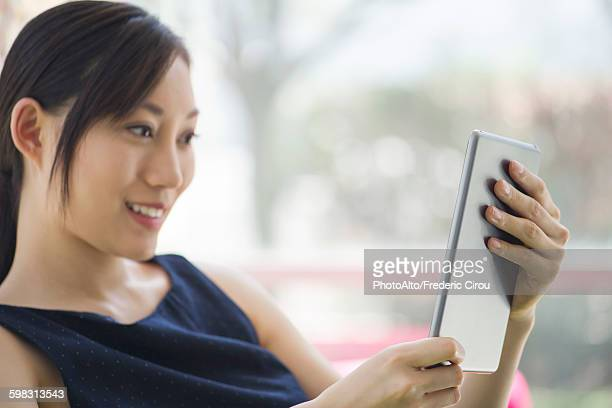 Woman relaxing with digital tablet