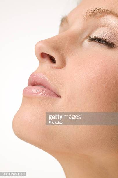 woman relaxing with eyes closed, posing in studio, close-up, portrait - nariz humano imagens e fotografias de stock