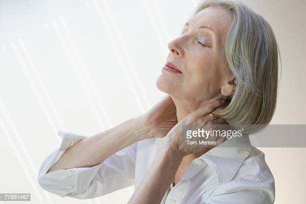 Woman relaxing with hands on neck