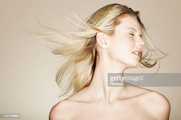 woman relaxing with her hair blowing in the wind - 裸 ストックフォトと画像