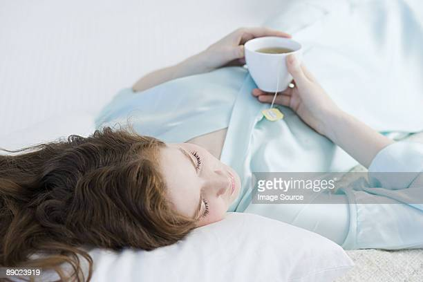 Woman relaxing with tea