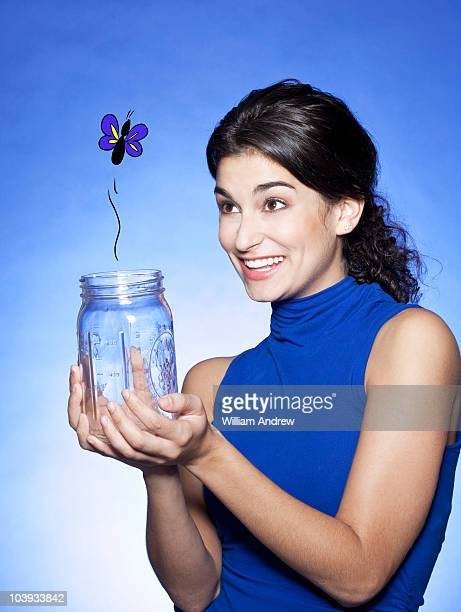 woman releasing butterfly from jar - cartoon characters with curly hair stock photos and pictures