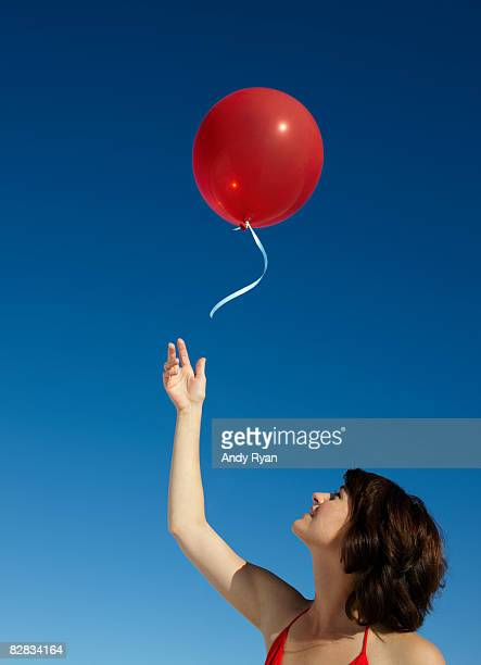 Woman Releasing Red Balloon