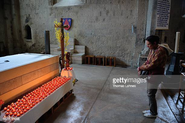 Woman remembers the victims of the Germanwings Airbus flight in a service at the 'Notre Dame du Bourg' cathedral on March 28, 2015 in...
