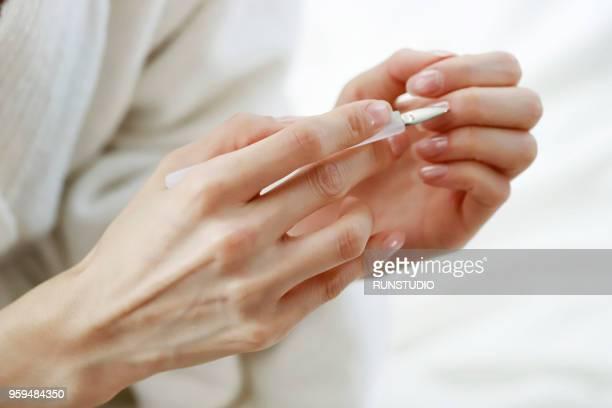 woman removing cuticle - 人の指 ストックフォトと画像