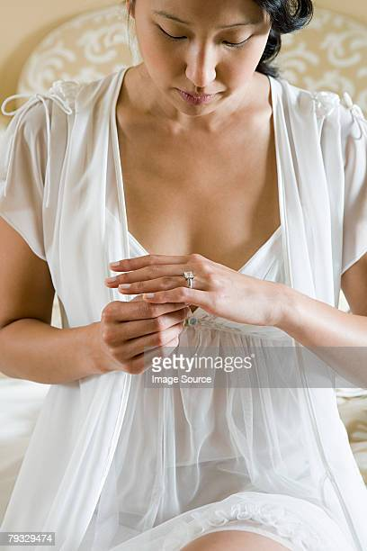 woman removing engagement ring - nightdress stock pictures, royalty-free photos & images