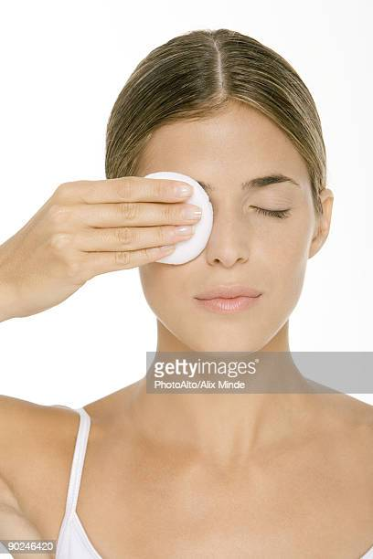 Woman removing eye make-up
