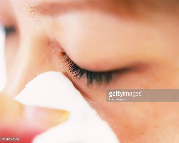 A Woman Removing Makeup with a Cotton, Differential Focus