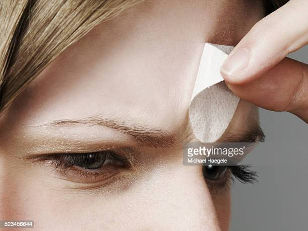 woman removing pore strip - pores stock photos and pictures