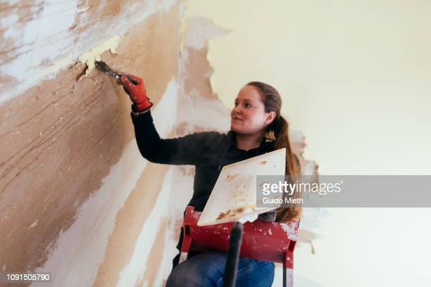 Woman renovating her home.