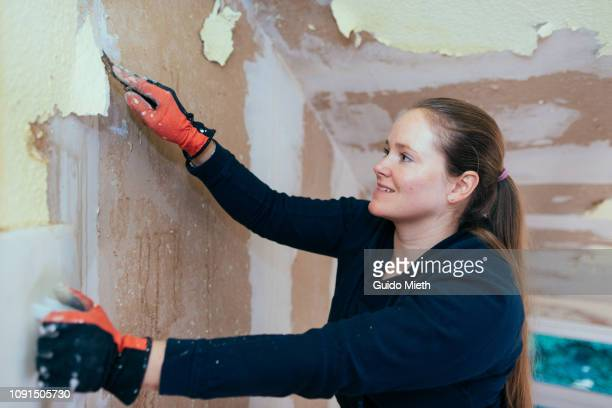 Woman renovating own house.
