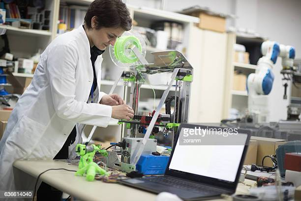 Woman repairing 3D printer