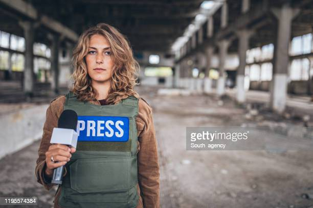 woman reporting live from the war zone - live event stock pictures, royalty-free photos & images