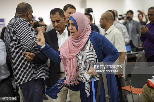 A woman representative of South Yemen reacts on June 18 2015 during clash at a press conference on Yemen peace talks held by Yemeni rebels in Geneva...