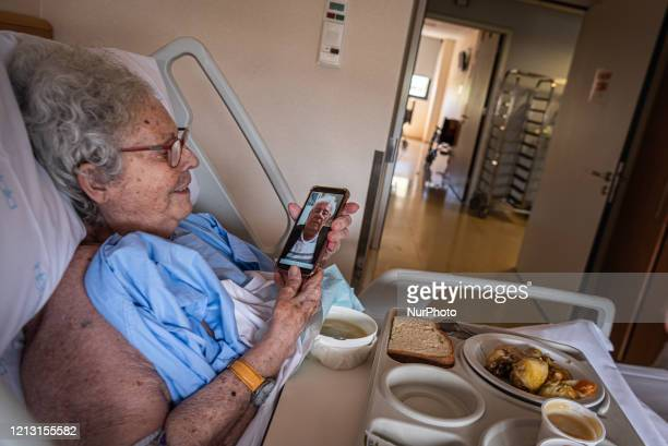 A woman resident of a nursing home is videocalling to her brother who lives in Australia in Palamos Spain on May 15 2020 during the coronavirus...