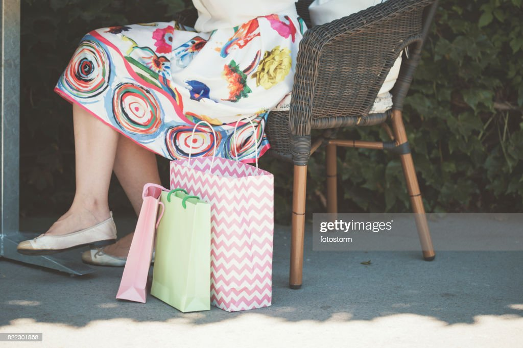 Woman resting after shopping : Stock Photo