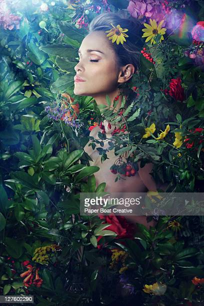 woman resting amongst many wild flowers