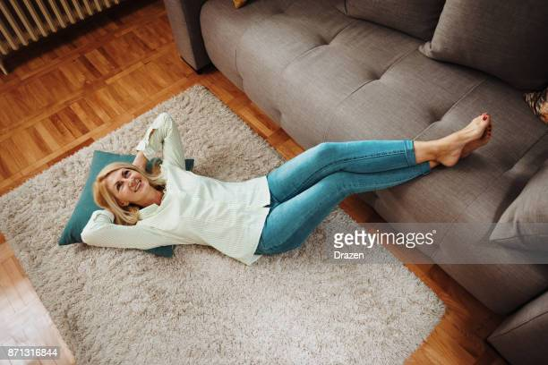 woman resting at home after work - smooth stock pictures, royalty-free photos & images