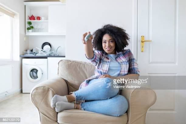 woman resting at home and watching tv - tv housewife stock photos and pictures