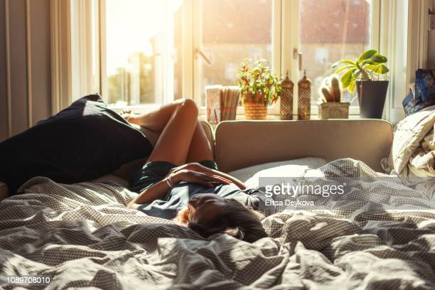 woman resting at home - cosy stock pictures, royalty-free photos & images