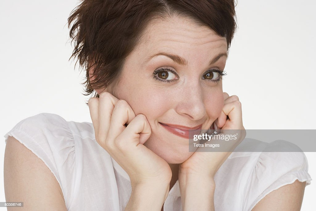 Woman resting chin in hands : Stock Photo