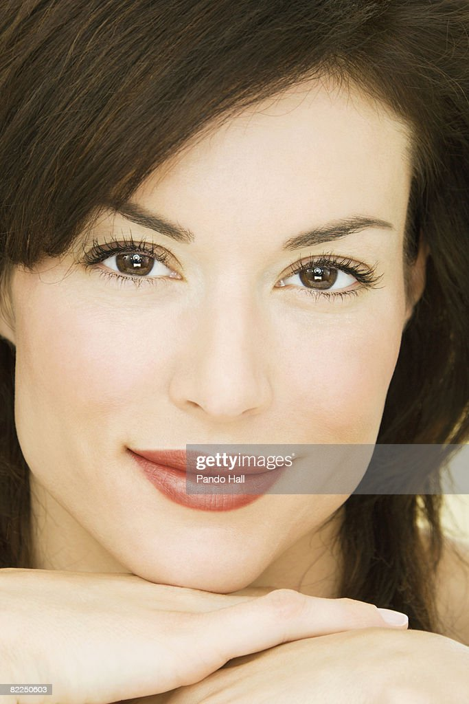 Woman resting chin on arm, close-up, portrait  : Stock Photo