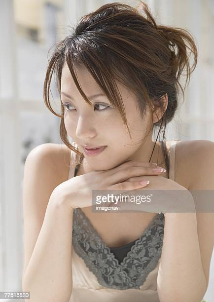 Woman resting chin on hand