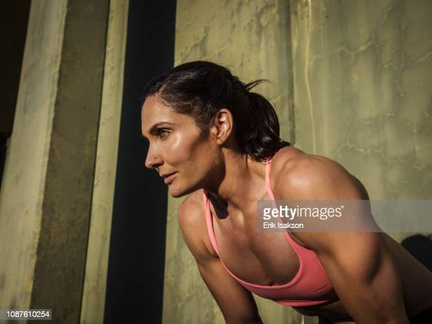woman resting during exercise - bend over cleavage stock photos and pictures