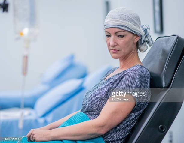 woman resting during iv drip cancer treatment stock photo - cancer illness stock pictures, royalty-free photos & images