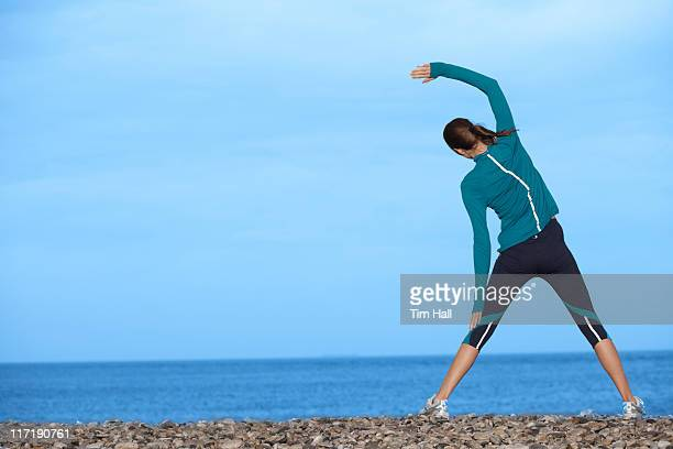 woman resting during rockclimb - legs spread woman stock photos and pictures