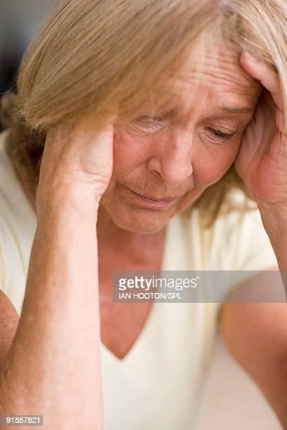 Woman resting head in hands