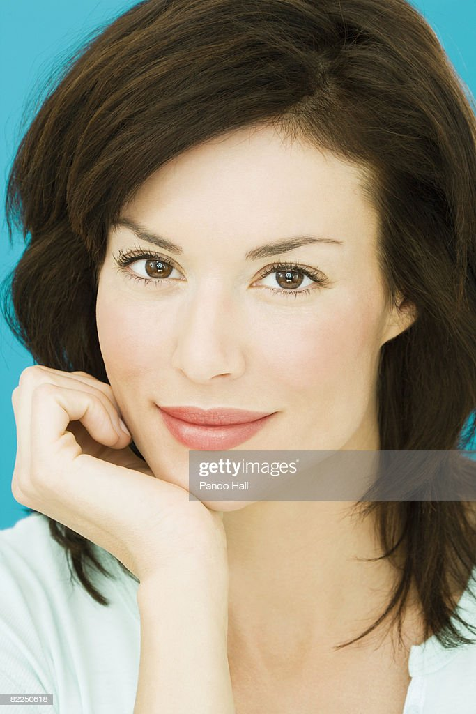 Woman resting head on hands, portrait : Stock Photo
