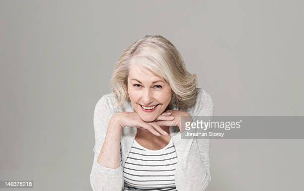 Woman resting her chin on her hands smiling