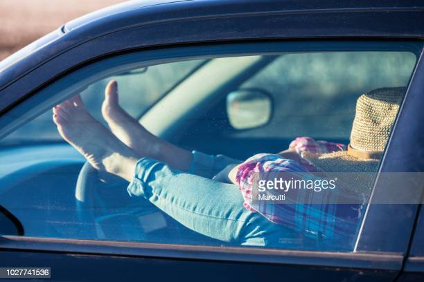 Woman resting in a driver's seat