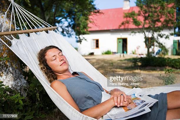 A woman resting in a hammock.