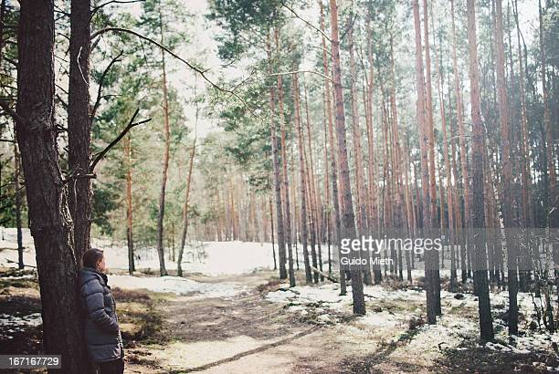 Woman resting in forest.