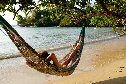 Woman Resting In Hammock At Bench - gettyimageskorea