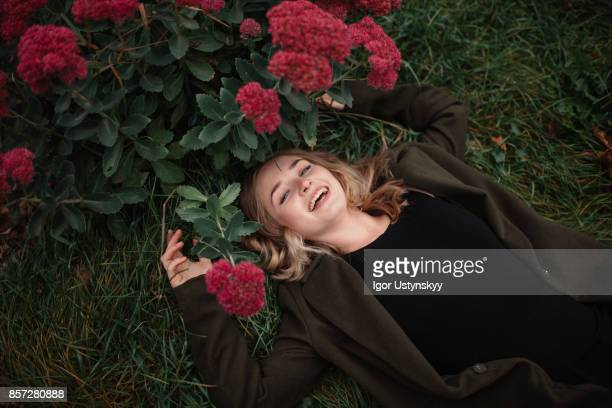 woman resting in the garden - red roses garden stock pictures, royalty-free photos & images