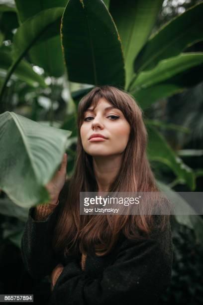 woman resting in the garden - beauty in nature stock-fotos und bilder