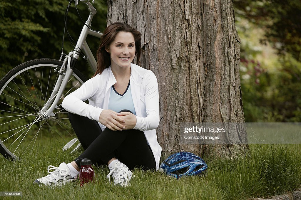 Woman resting near bicycle : Stockfoto