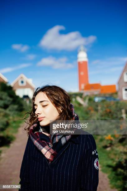 Woman resting near the Eierland Lighthouse, Texel